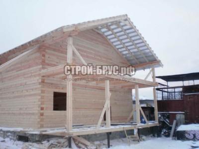 Дом из профилированного бруса террасой и балконом